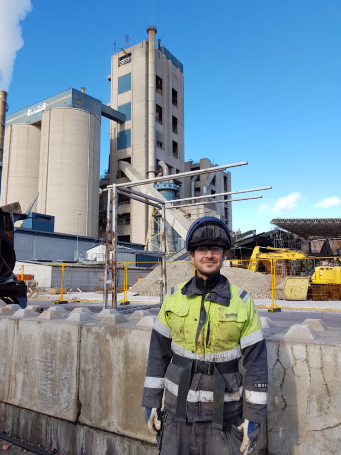 Christian Roman posing in front of the Cementa factory